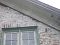 [picture: Brick damage at the eaves: another view]