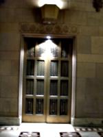 [picture: Gold elevator door]
