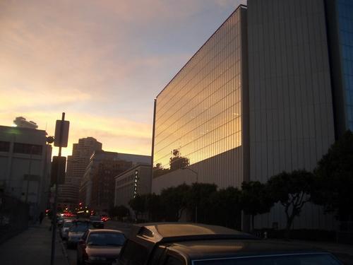 [Picture: Sun reflecting off skyscraper]