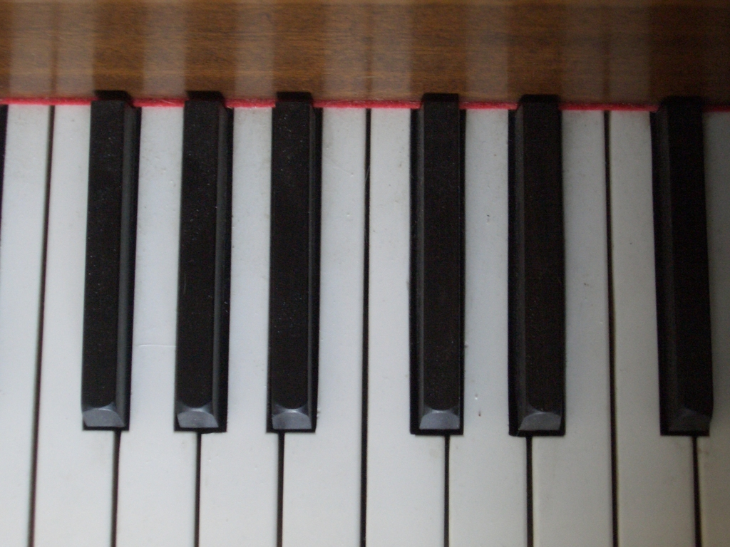[Picture: Piano keys from above]