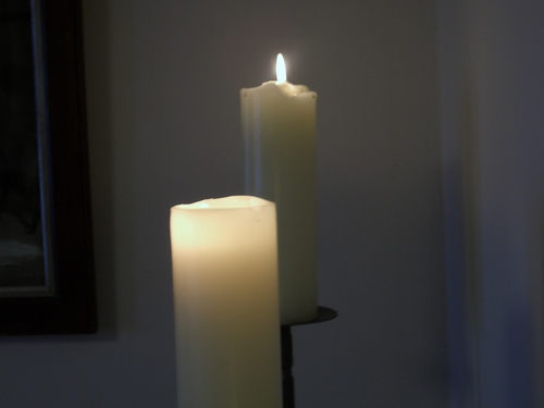 [Picture: Two lit candles]