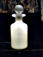 [picture: Antique white glass bottle 2]