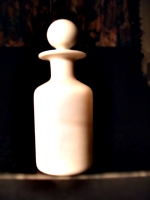 [picture: Antique white glass bottle 3]