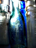 [picture: Old bottles in daylight]
