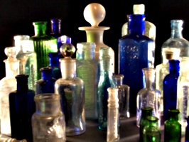 [Picture: Collection of old bottles]