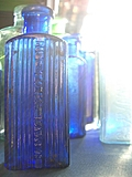 [Picture: Blue antique medicine bottle with strong light]