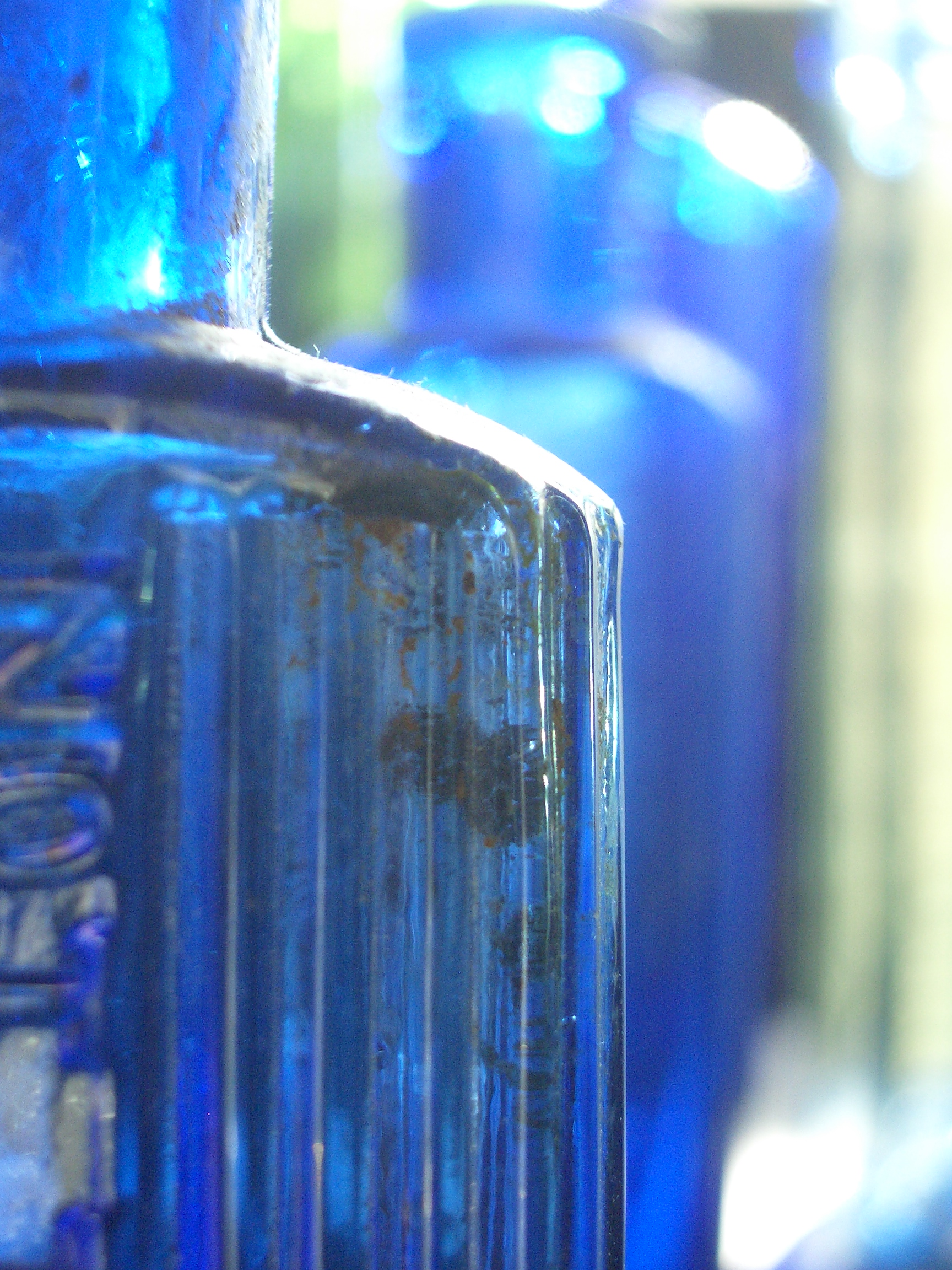 [Picture: Blue antique medicine bottle with strong light 2]