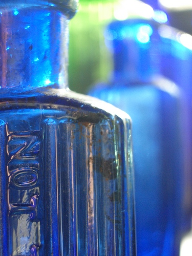 [Picture: Blue antique medicine bottle with strong light 3]