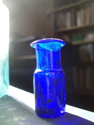[Picture: Tiny blue glass bottle]