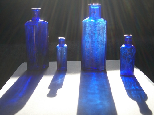 [Picture: Four medicine bottles with sunlight streaming past]