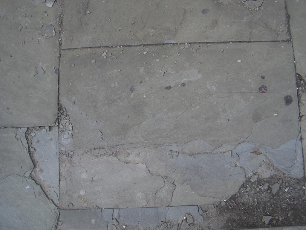 [Picture: Broken pavement]