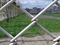 [Picture: chain-link fence outside school]