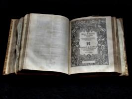 [picture: Geneva Bible open part-way]