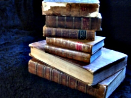 [Picture: Another pile of old books]