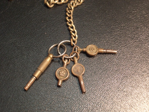 [Picture: Antique watch keys]