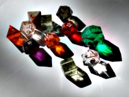 [picture: coloured plastic gaming dice]
