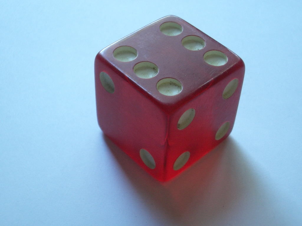 [Picture: A red glass (or resin) dice]