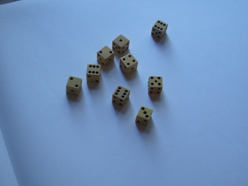 [Picture: Ivory dice]