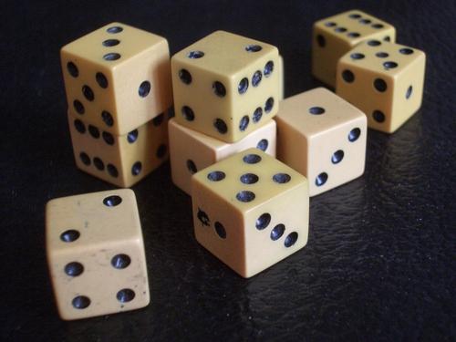 [Picture: ivory gaming die]
