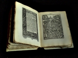 [Picture: Old Bible 4, open at a woodcut]