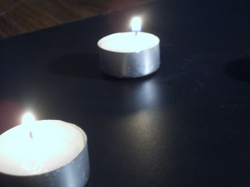 [Picture: Two Tea lights]