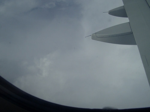 [Picture: Clouds through the porthole]