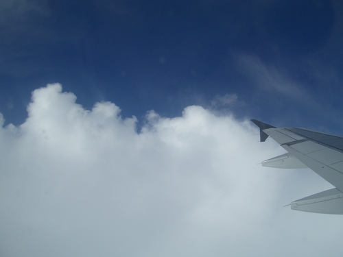 [Picture: Clouds, blue sky, wing]