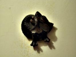 [picture: Decorative gargoyle]