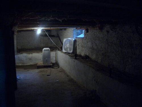 [Picture: Basement with fan]