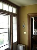[Picture: Yellow wall, white radiator.]
