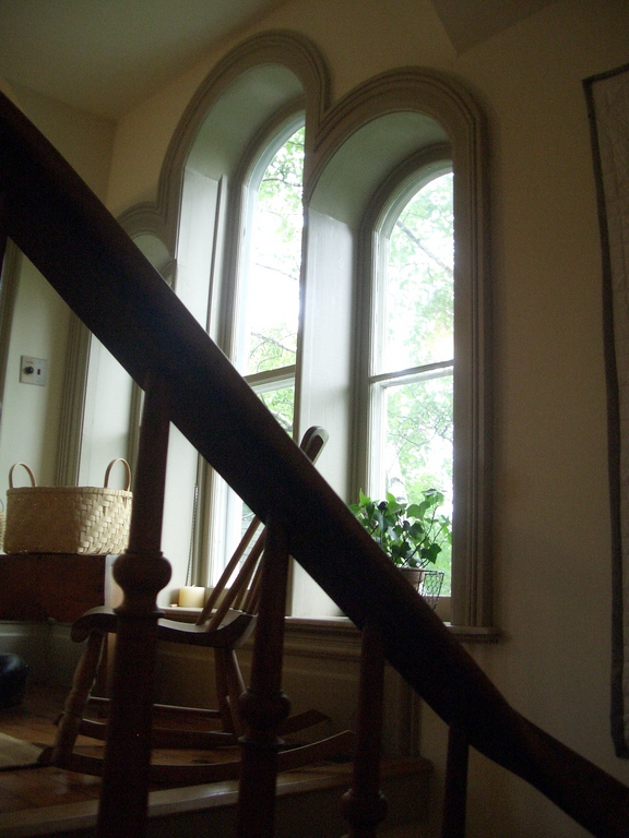 [Picture: Rounded windows with rocking chair]