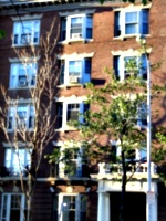 [Picture: Brick building with bay windows and trees]