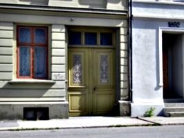 [picture: Carved wooden doorway]