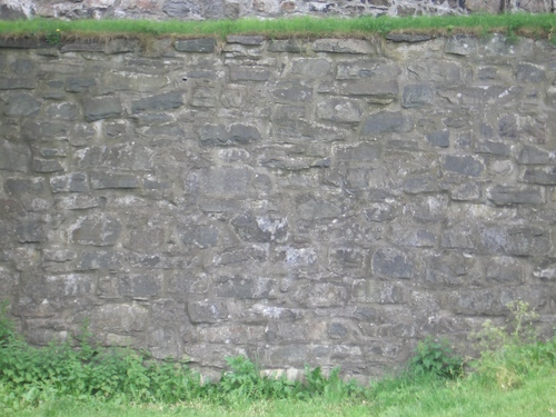 [Picture: Grey stone wall]