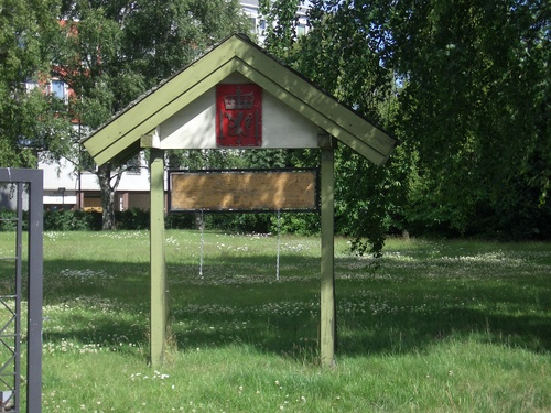 [Picture: Blank sign board in a park]