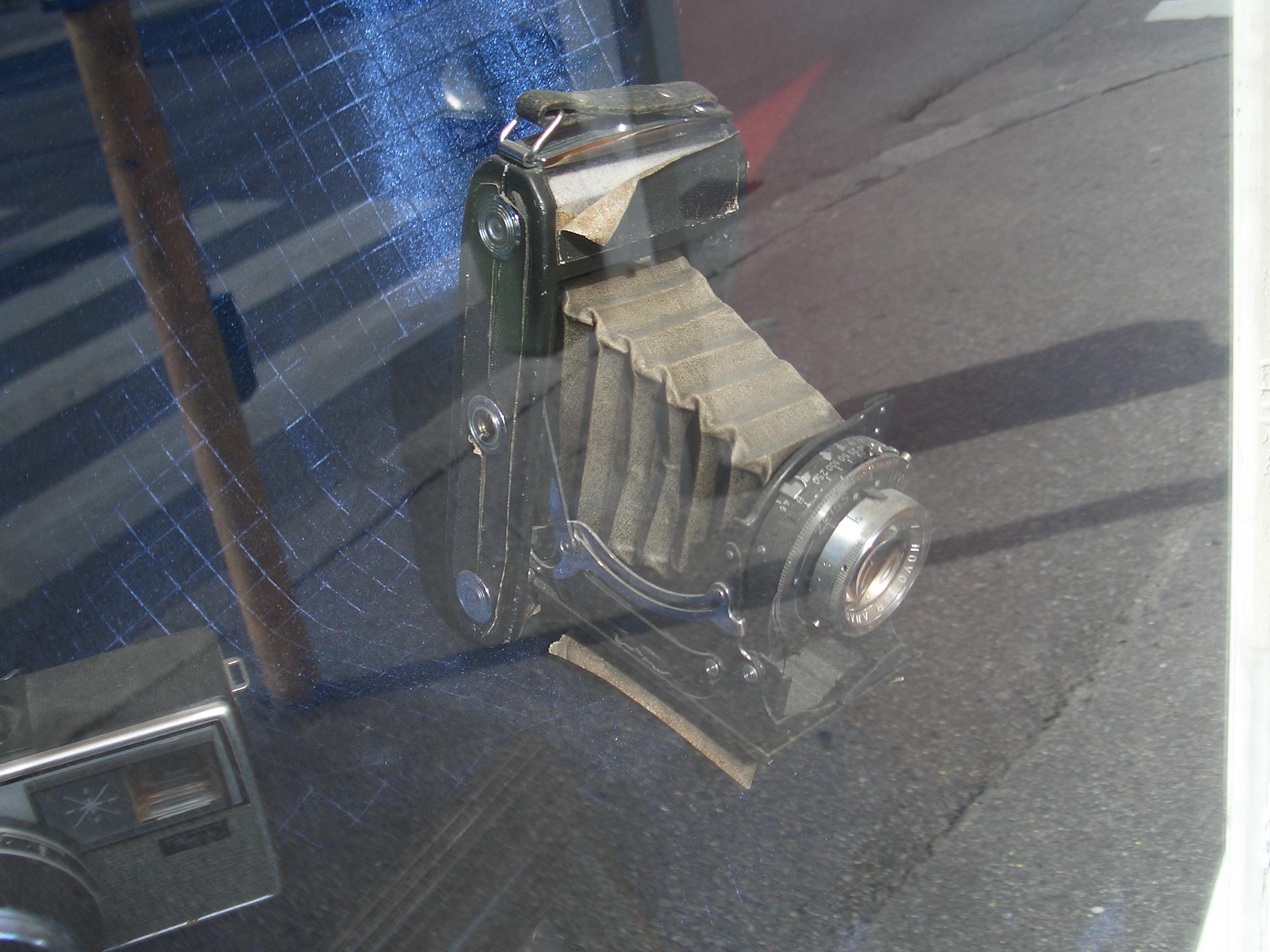 [Picture: Camera Shop Window]