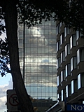 [Picture: Sunset reflected in glass skyscraper]