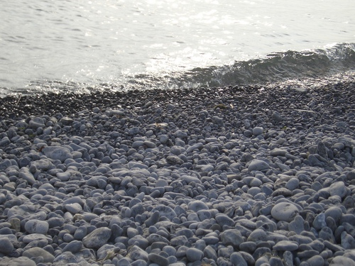 [Picture: Waves lapping the beach]