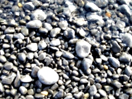 [Picture: Pebbles on the edge of the water]