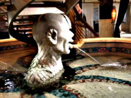 [picture: Statue: Stone head with scales and fountain]