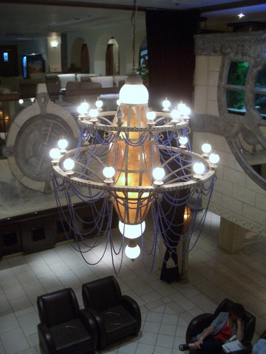 [Picture: Hotel lobby chandelier from above]