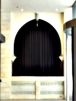 [Picture: Arch with velvet curtain]