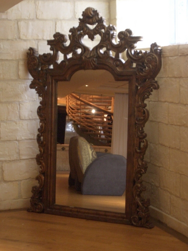 [Picture: Mirror with ornate gold frame]
