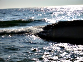 [picture: Waves on rock]