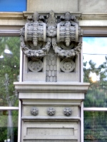 [picture: Carved laurel wreath corbels]
