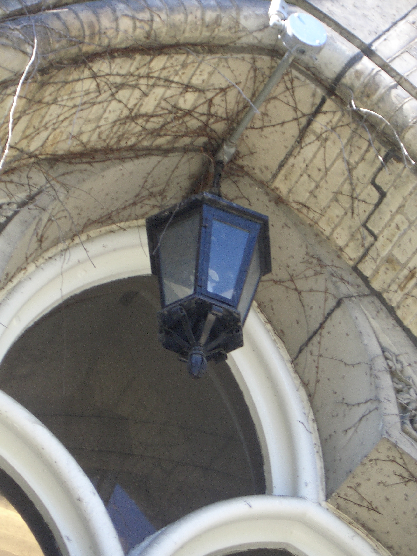 [Picture: Lantern in arched doorway]