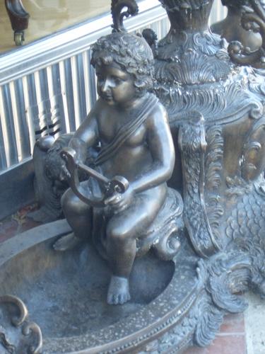 [Picture: Cherub statue]