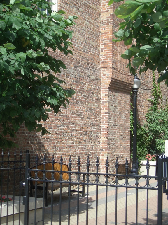 [Picture: Old brick wall and seat]