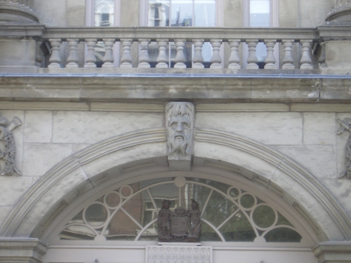 [Picture: Carved man's face]
