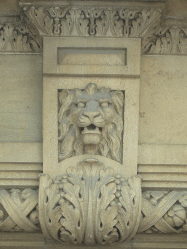[Picture: Carved stone lion's head]